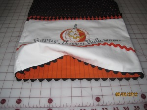 Here is the finished version of the Halloween pillow case. I just love the colors of orange and black - they really pop.