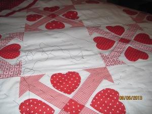 basting Valentine quilt top